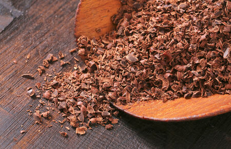 semisweet: Grated chocolate on wooden scoop