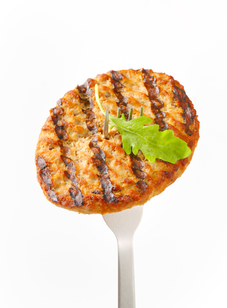 chicken burger: Grilled patty on a fork