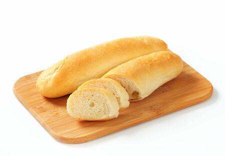 pain blanc: White bread rolls on cutting board
