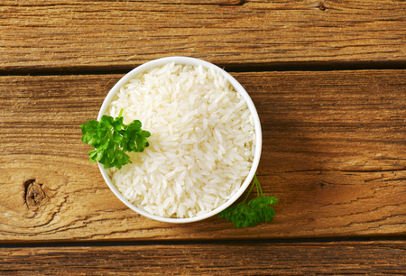 staple food: Bowl of uncooked white rice