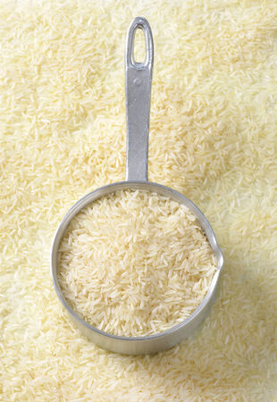 Uncooked Jasmine rice in a saucepan photo