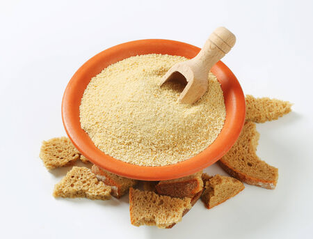 breading: Bowl of dry bread crumbs Stock Photo