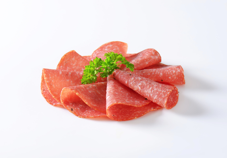 fermented: Thin slices of fermented salami Stock Photo