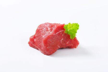 red meat: Chunk of raw beef steak on white background