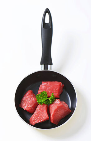 Raw diced beef in a pan photo