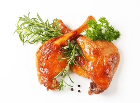 Rosemary scented roast duck legs photo