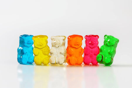 Fruit flavored gummy bears in assorted colors photo