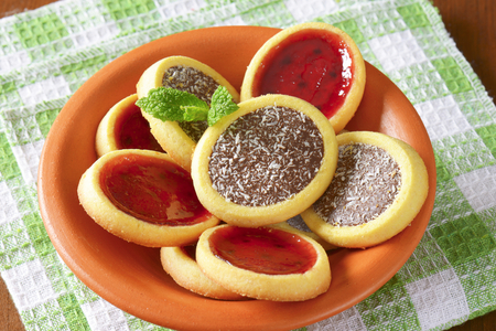 jam tarts: Mini tarts with jam and chocolate coconut filling