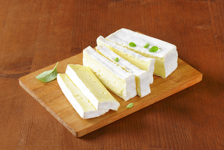 rind: French cows milk cheese with white rind Stock Photo