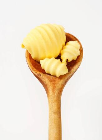 curls: Butter curls on wooden spoon