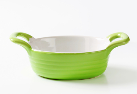 Empty green ceramic baking dish photo