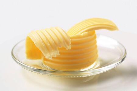 curls: Butter curls on glass plate