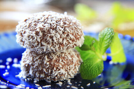 confections: Chocolate coconut confections filled with cream Stock Photo