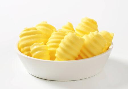 curls: Curls of fresh butter in glass bowl