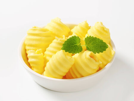 curls: Curls of fresh butter in bowl