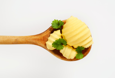 Butter curls on wooden spoon photo