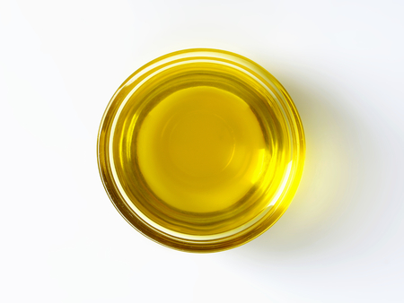 extra virgin olive oil: Olive oil in glass bowl Stock Photo