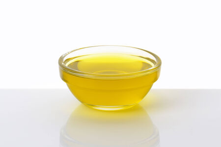cooking oil: Olive oil in glass bowl Stock Photo
