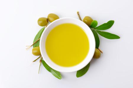 Olive oil in white porcelain bowl photo