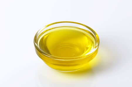 Olive oil in glass bowl photo