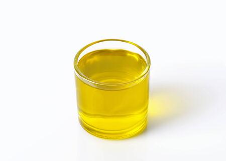 extra virgin olive oil: Glass of extra virgin olive oil
