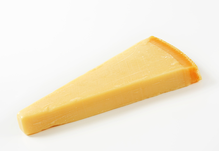 wedge: Wedge of Parmesan cheese on white background