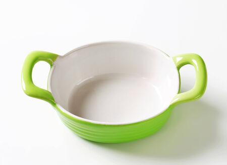 Empty green ceramic baking dish photo
