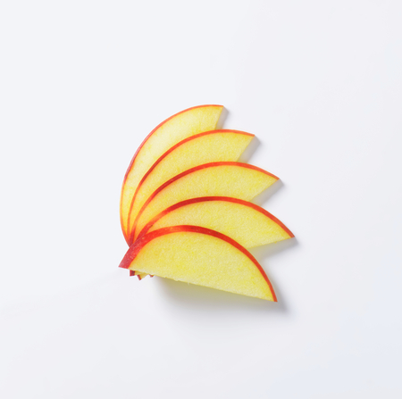Slices of apple on white background