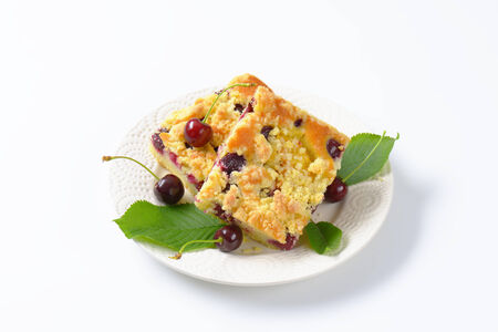 sour cherry: Sour cherry crumb bars on white plate Stock Photo