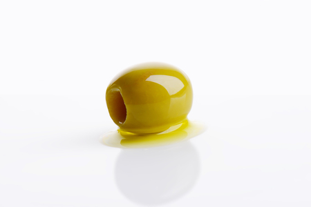 pitted: Pitted green olive on white background
