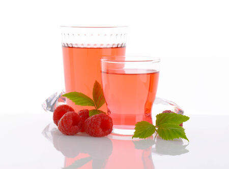 fruit in water: Glasses of fruit water and fresh raspberries