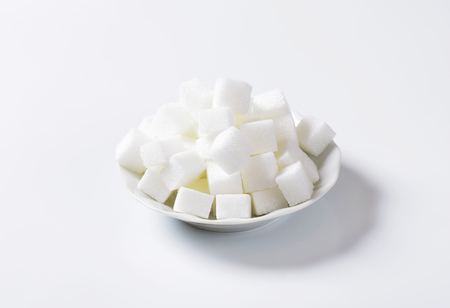 sugar cubes: Pile of white sugar cubes Stock Photo