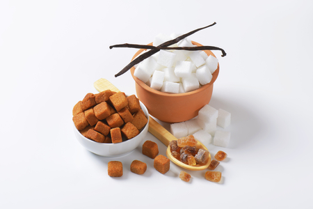 White and brown sugar cubes and rock sugar photo
