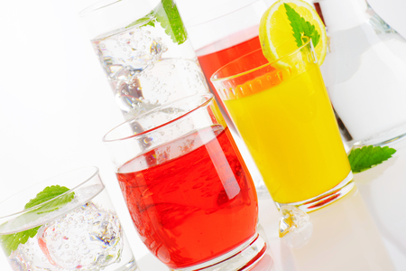 fizzy: Glasses of fizzy water and fruit-flavored drinks