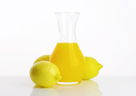 Fresh lemon juice drink  in a carafe