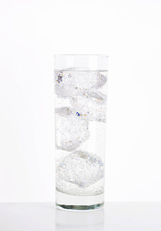 sparkling water: Glass of sparkling water with ice Stock Photo