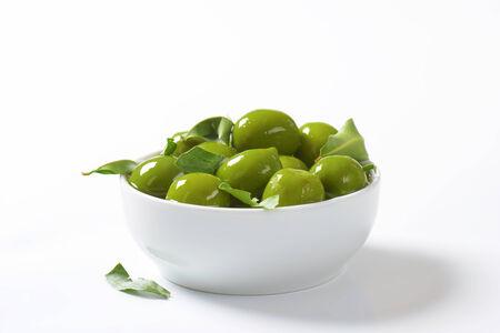 green olives: Bowl of green olives in oil