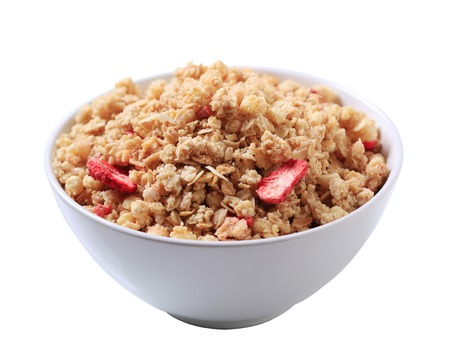Bowl of strawberry almond granola cereal Stock Photo