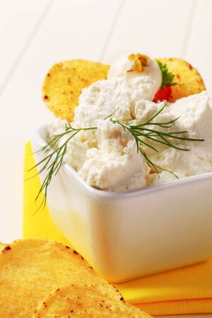corn chips: Corn chips and bowl of curd cheese
