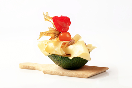 swiss cheese: Avocado fruit and slices of Swiss cheese