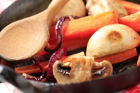 seared: Pan seared mushrooms, and strips of carrot Stock Photo