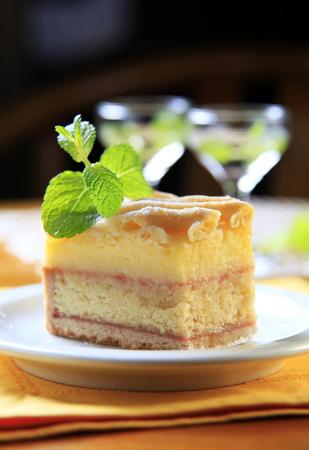 rum cake: Slice of liquor soaked cake with lattice topping Stock Photo