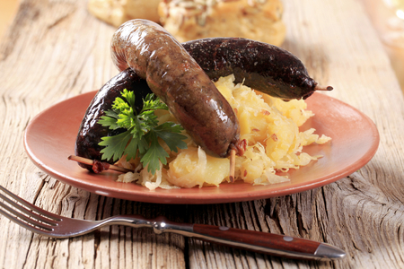 Pan roasted sausages with sauerkraut and potatoes Standard-Bild