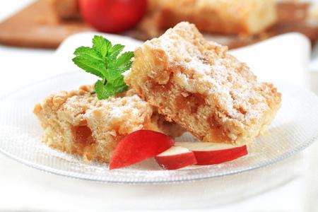 crumb: Pieces of apple crumb cake