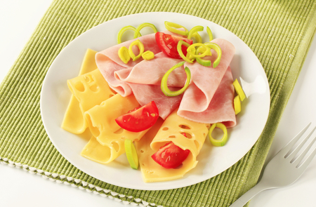 swiss cheese: Slices of ham and Swiss cheese sprinkled with chopped leek