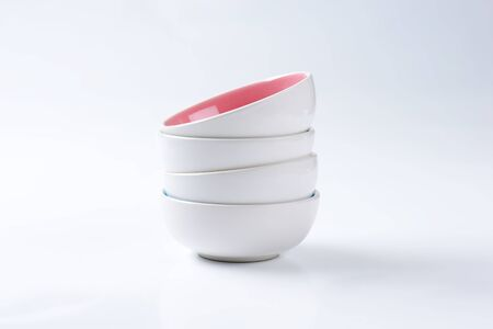 two tone: Stack of round two tone bowls