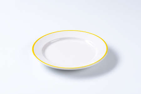 rimmed: Rimmed dinner plate with yellow colored edge