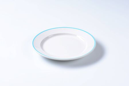 rimmed: Rimmed dinner plate with blue colored edge