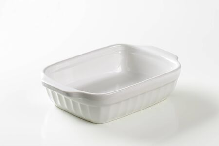 casserole dish: Classic white ceramic casserole dish with handles Stock Photo
