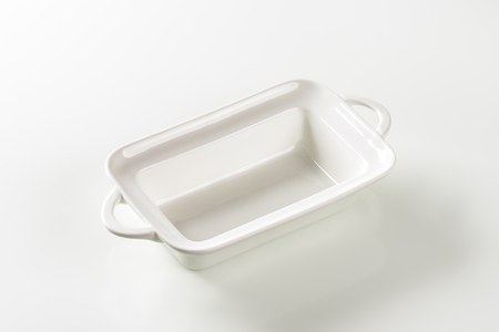 Deep rectangular white ceramic dish with handles photo